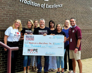 NIceville Strong presents check
